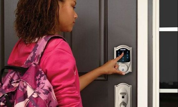 girl unlocking door